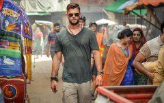 Fair use from Netflix. Tyler Rake (Chris Hemsworth) walks through the streets of Dhaka, Bangladesh.