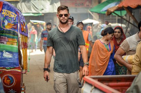 Fair use from Netflix. Tyler Rake (Chris Hemsworth) walks through the streets of Dhaka, Bangladesh.