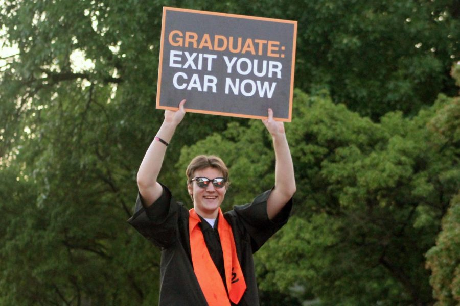 Graduate Elliot Rickert greets friends and family during the car parade June 23. St. Louis Park celebrated the graduation ceremony in the high school parking lot June 23.