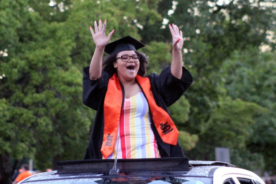 Graduate Madison Henry waves to friends and family during the car parade June 23. St. Louis Park celebrated the Graduation ceremony in the high school parking lot June 23.
