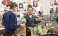 Echowan staffers senior Sara Wojtasiak and junior Lauren Whiteman bag groceries Jan. 19 at Cub Foods. The club hosted the fundraiser to raise funds for the year.