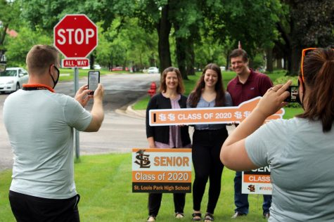 Principal Scott Meyers and assistant principal Jessica Busse take pictures of senior Elizabeth Reuter after delivering her Graduation box May 27. A car Graduation ceremony will take place June 23 in the parking lot at Park. Speakers and other video elements will be projected onto large screens.