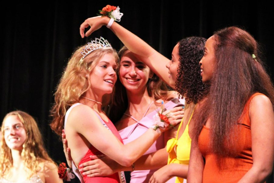 Seniors Miriam Hope, Alyscia Thomas and Zara Fakier congratulate senior Hattie Kugler after being crowned Homecoming queen. Coronation was held Sept. 18 in the Auditorium.