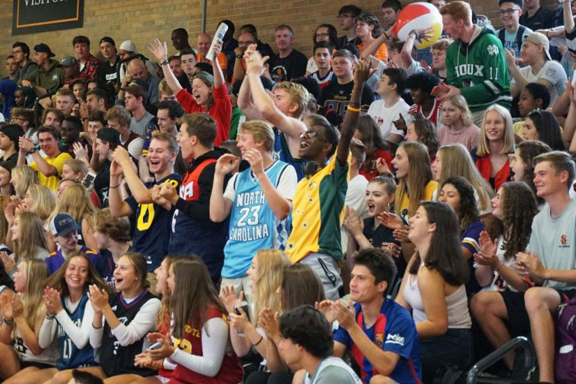 The senior class stands and cheers with excitement at the first day of school Pep fest Sept. 3. The class wore jerseys to show their senior pride.