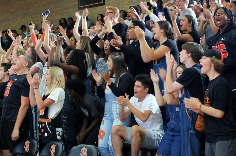 The senior class rises in applause to show Park pride Sept. 20. Court members were announced Sept. 13 at a previous Pep fest.