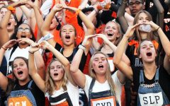 Senior ladies lead a chant to cheer for the football team at the Homecoming football game Sept. 20. Seniors pumped up the crowd as Park played against Spring Lake Park.