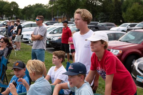 Sophomores Charlie Poulter and Miles Rider, along with other Park students, spectate the girls' varsity tennis match Aug. 26. Spectators were encouraged to wear masks and social distance by the Park sports administration.