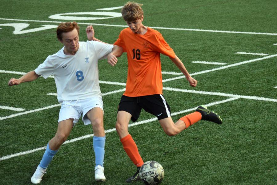 Junior Joseph McGurgan goes to kick the ball Sept. 15. Park won 4-0 against Bloomington Jefferson