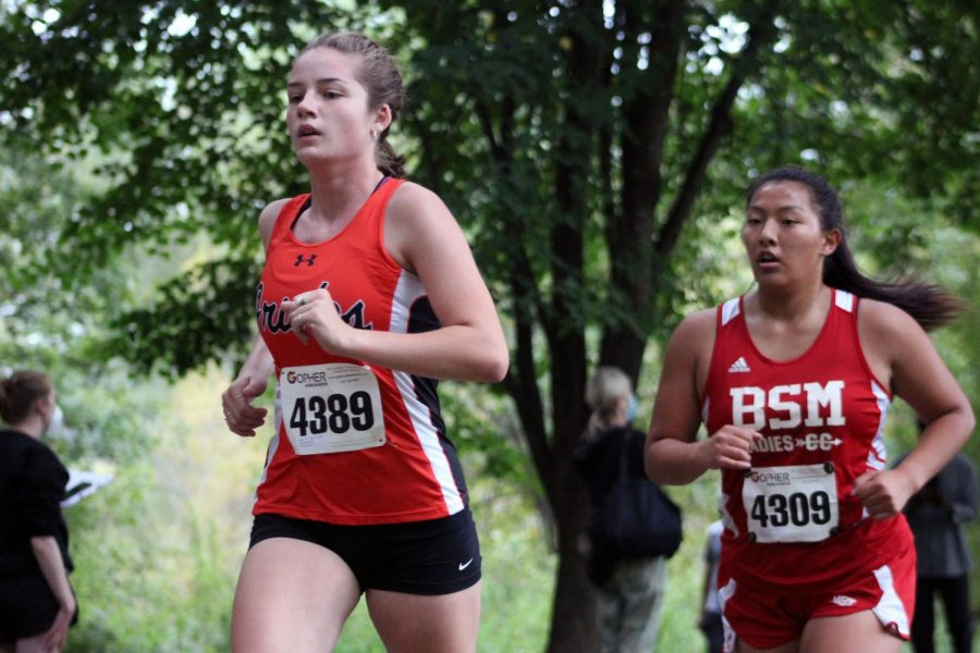 Senior Lucy Zumbrunnen runs past spectators Sept. 26. Benilde-St. Margaret's held the meet at Basset Creek Park with a total of three teams competing.