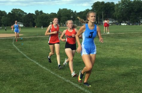 Eight graders Sela Myers and Nora Lindman run alongside a Bloomington Jefferson runner Sept. 4. Park began their season by hosting their first home meet in 20 years.