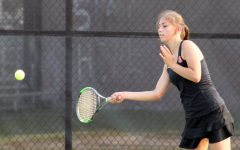 Sophomore Zoe Gutz reaches for the ball to hit back to her opponent. Gutz played a tough singles match but ultimately lost.