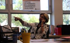 Interim Principal Wendy Loberg takes a call while working. Loberg previously served as principal of Maple Grove Senior High School.