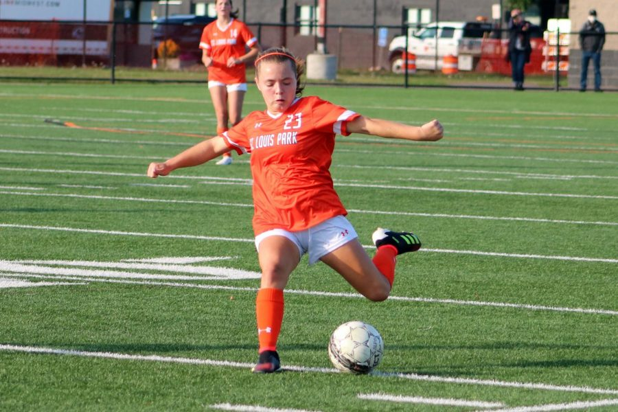 Freshman Vesna Dennison strikes the ball Sept. 10. Homecoming coronation will take play between the girls and boys soccer game at the stadium Sept. 29.