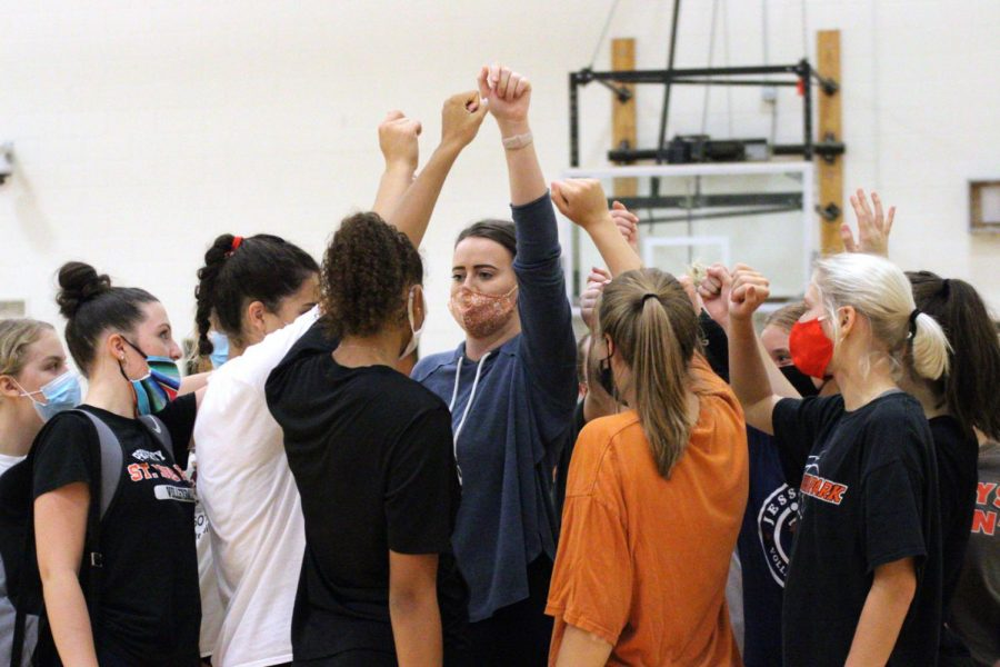 The varsity volleyball team wraps up practice with a team huddle Sep. 23. Varsity team tryouts are going to be held 6 p.m. Sept. 8 at the St. Louis Park Activity Center.