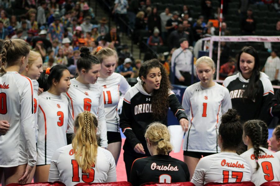 Whitney Meierotto-Simon, former head coach of the girls' volleyball team, strategizes with the rest of the group Nov. 8, 2019. The fall seasons of volleyball and football were both reinstated Sept. 21, 2020 despite the ongoing COVID-19 pandemic.