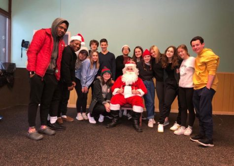 Used with permission from Emma Amon. DECA members pose for a picture at its Family Partnership collaboration Dec. 20, 2019.