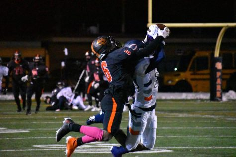 Senior Derric Standifer jumps to grab the ball from the opposing team Oct. 23. Park lost 41-20 against Robbinsdale Cooper.