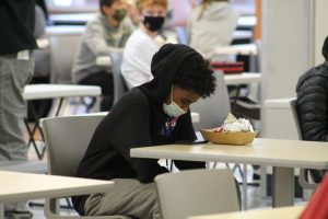 Students eat their lunches at socially distant tables Oct. 26. Due to the budget overage, many nutrition staff providing these lunches will be voluntarily furloughed.