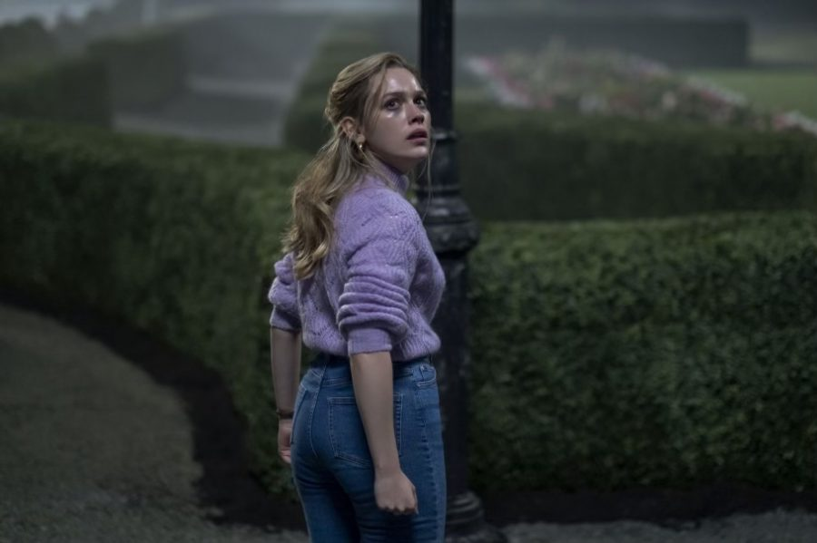 "Fair use from Netflix. Frightened by what she saw, Dani (Victoria Pedretti) looks back at the Bly Manor. Recently released on Netflix Oct. 9, ""The Haunting of Bly Manor"" is a horror follow up series to ""The Haunting of Hill House"" and is inspired by the 1898 novel, ""The Turn of the Screw,"" written by Henry James."