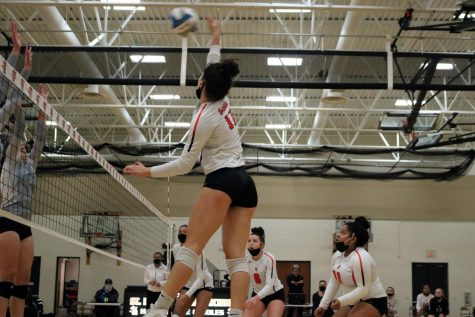 Senior Hannah Howell hits the ball over the net in a game against Bloomington Jefferson Oct. 23. Park lost with a final set score of 1-3.