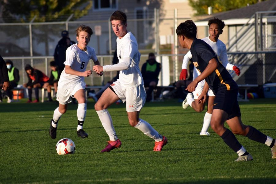 Junior Danny Lainsbury runs to take the ball from the opposing team Oct. 1. Park won 3-2 against Bloomington Kennedy.