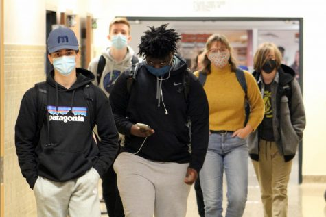 A group of students walk from class to lunch Oct. 26. Students are required to wear masks and practice social distancing while attending school in person.