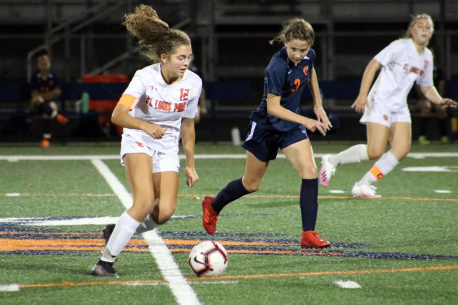 Junior captain Alma Beaton dribbles the ball around a Robbinsdale Cooper player during the match Oct. 6. Park won with a final score of 2-1.