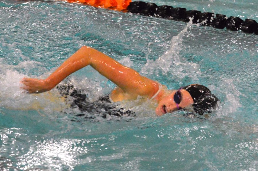 Senior Gabbie Kruse swims in a freestyle relay Oct. 8. This was the last home meet for the seniors on the team.