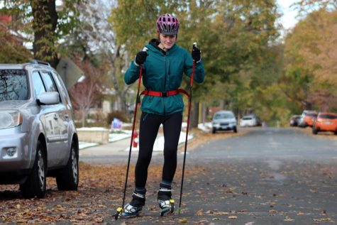 Senior co-captain Olivia Etz roller skis down a neighborhood road Oct. 26. Olivia is a three-season athlete competing in cross country, nordic and track.