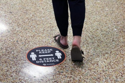 "Photo illustration by Talia Lissauer. ""Please keep 6 feet distance"" stickers have been placed throughout the hallways at Park. Other precautionary measure  have been put in place to prevent the spread of COVID-19 including following social distancing guidelines and the use of face coverings."