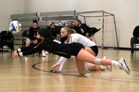Junior Elsa Bergland dives for the ball in a game against Robbinsdale Cooper Oct. 27. Park won with a final set score of 3-0.