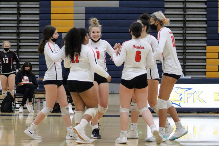 SLP girls volleyball celebrates after scoring another point against Bloomington Kennedy during the Oct. 13 match. Park won with a final set score of 3-0.