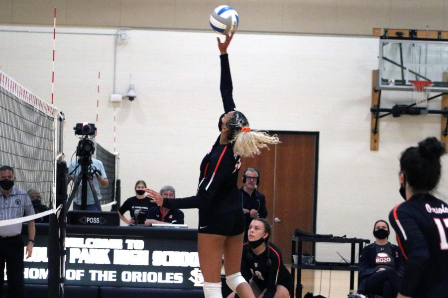 Senior Kendall Coley blocks the ball from coming over the net in a game against Chanhassen Oct. 15. Park won with a final set score of 3-2.