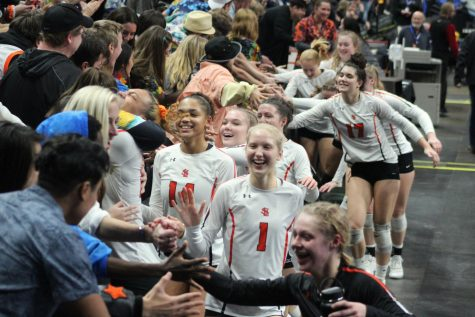The girls' volleyball team high fives the fan section after a victory against Moorhead Nov. 8, 2019.