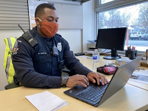 School resource officer Maurice Smith types on his laptop in his office at Park. Smith applied due to his passion for working with kids and began his new role for the 2020-21 school year.