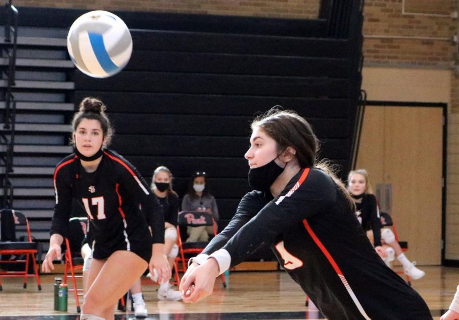 Junior Elsa Bergland hits the ball in the game against Benilde-St. Margaret's Nov. 7. Park won with a final set score of 3-0.