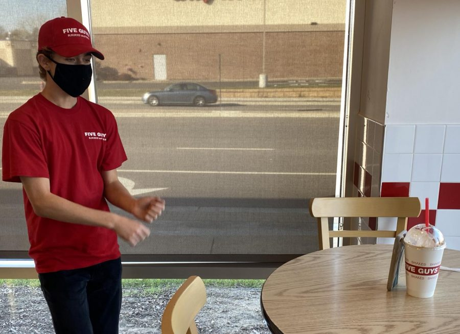 Junior Gavin Thoe makes a dancing TikTok while on break at his job at Five Guys. Thoe has gained 103 thousand followers since he began making TikToks in November 2018.