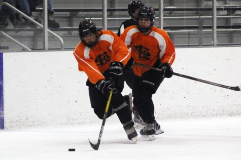 Senior Austin Amelse maintains control of the puck as he skates up the ice toward Osseo's goal. Park lost 9-3 to Osseo.