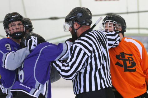 Senior Drew Boyum gets into an argument with an opposing player while the referee breaks them up Oct. 31. Park won against Buffalo 5-3.