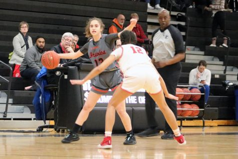 Senior Sadie Yarosh looks for a teammate to pass the ball to. The girls basketball season got postponed due to COVID-19.