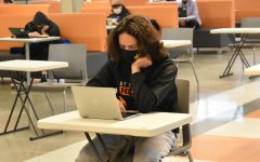 Students study in the lunchroom Dec. 16. Virtual learning can have negative effects on both mental and physical health.