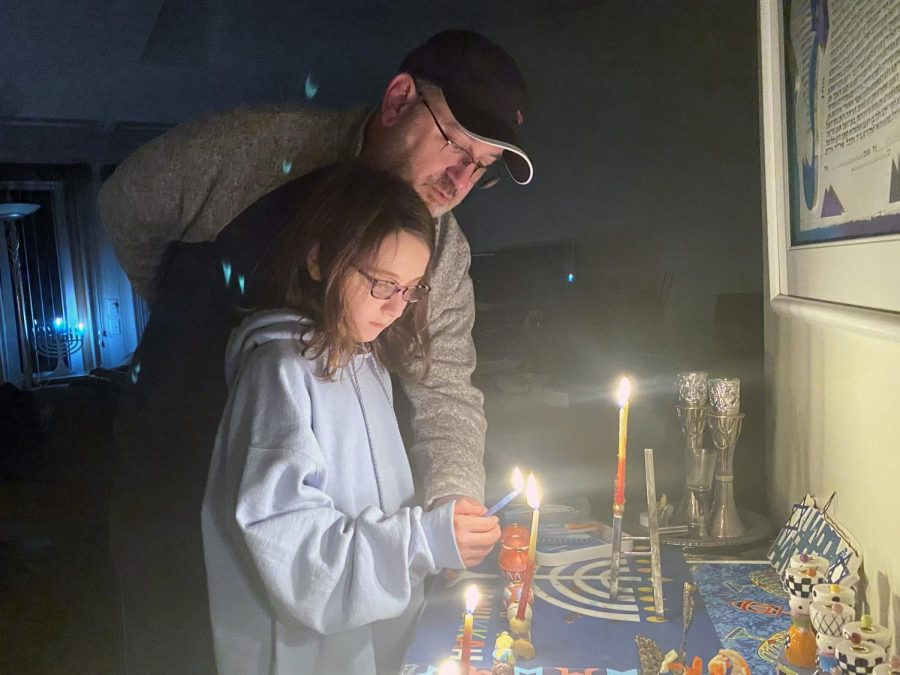 Addie and Jeff Prottas celebrate Hanukkah while lighting the candles Dec. 10. Celebrating the holidays is one of the many activities to do over winter break.