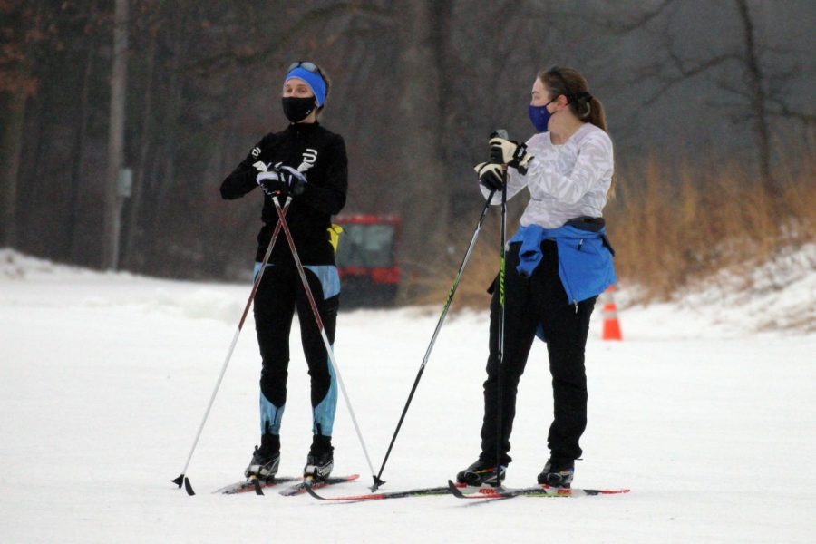 Two girls ski at Theodore Wirth Park Dec 23. Skiing is a COVID-friendly way to spend time with friends, as long as precautions are taken.