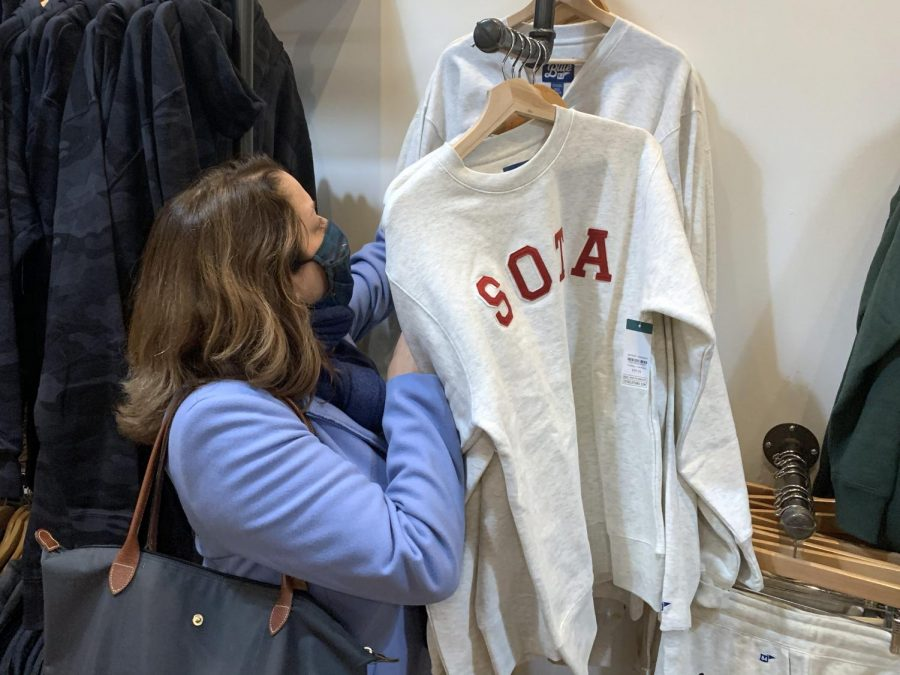 Park resident Jennifer Harper shops at Sota Clothing. Small businesses like this one have to learn how to adapt to COVID-19 daily.