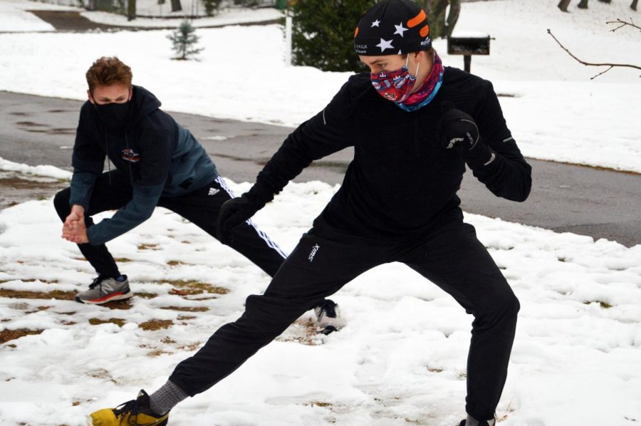 Senior captain Danny Walsh and senior Benn Katzovitz warm up during Nordic captains practice. These practices were canceled due to CDC guidelines.