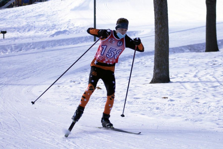 Senior Benn Katzovitz picks up speed from large downhill to create momentum into the next hill Jan. 21. A total of 44 skiers from Park competed at this race.