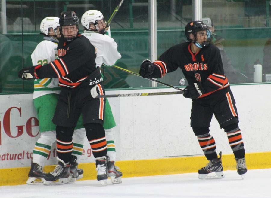 Senior McCabe Dvorak and junior Stanley Regguinti fight off two Edina players. Athletes have not been wearing their masks properly after Gov. Tim Walz new guidelines.