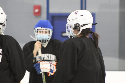 Senior Abby Meyer listens to coach during practice. Meyer committed to playing both hockey and lacrosse at Lake Forest college, a Division III school in Illinois.
