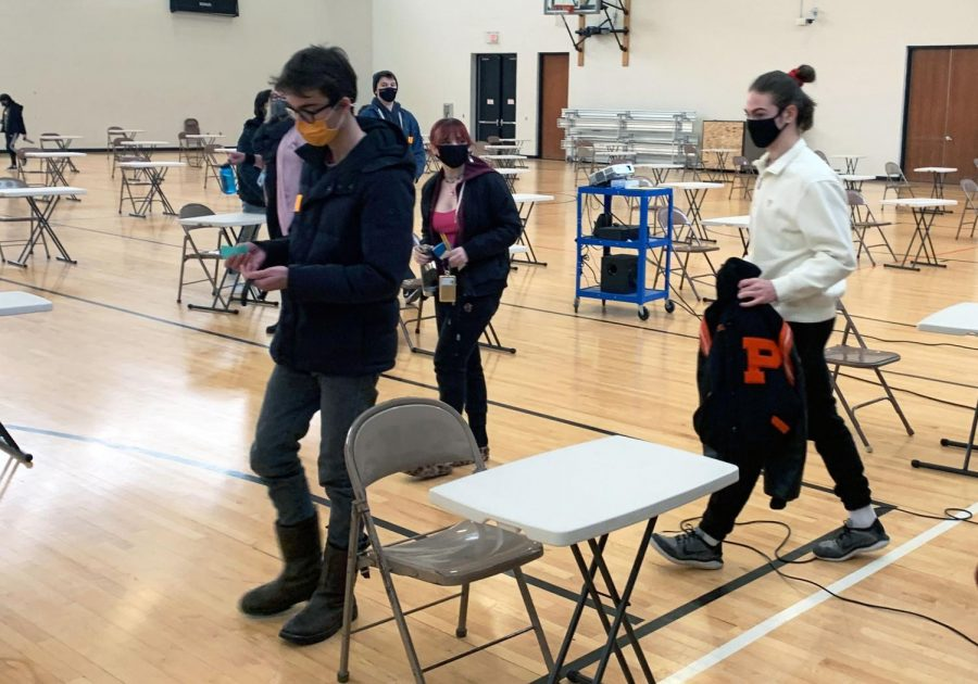 Students exit the field house after taking the PSAT Jan. 27. Students were required to wear masks and desks were distanced six feet apart in compliance with COVID-19 guidelines.