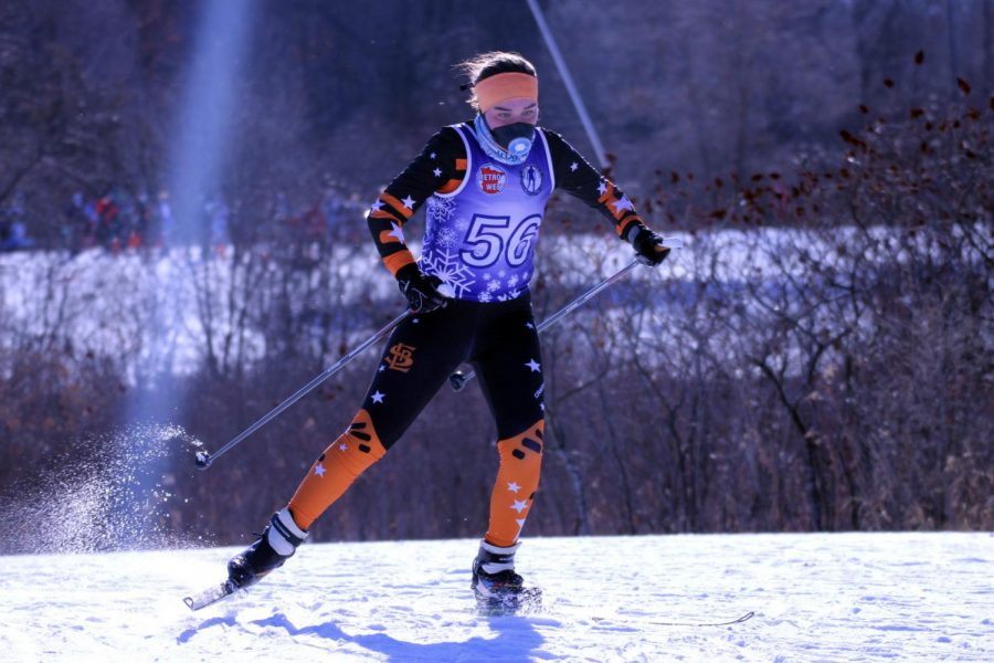 Senior Claire Bargman uses a diagonal stride to push herself up a hill Jan. 21. For races, Bargman wears a special mask to help with breathing.